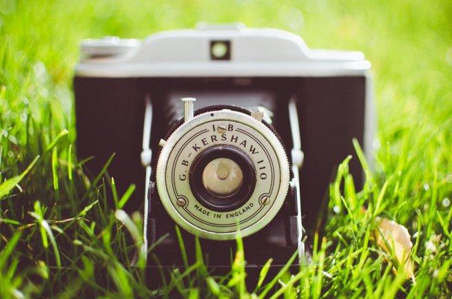 a-camera-the-camera-lens-grass-green